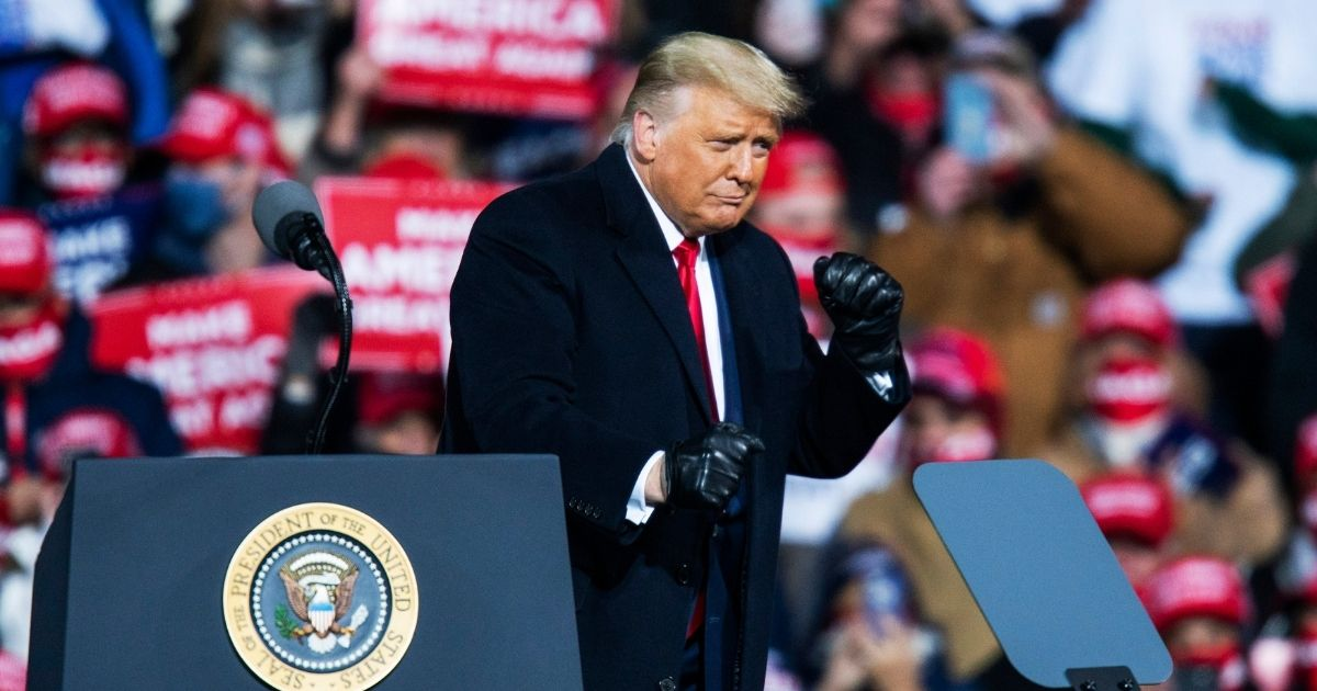President Donald Trump dances after speaking to supporters during a rally on Saturday in Montoursville, Pennsylvania.