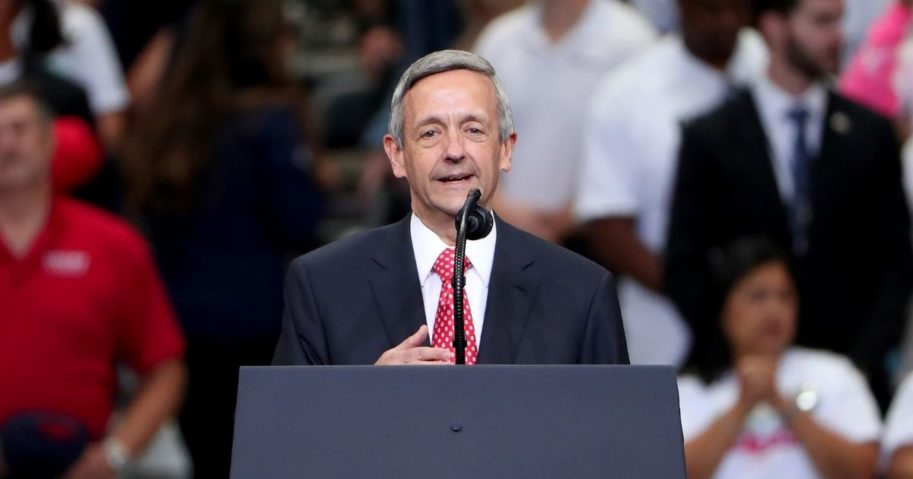 """Evangelical pastor Robert Jeffress leads the Pledge of Allegiance before President Donald Trump speaks during a """"Keep America Great"""" campaign rally at American Airlines Center on Oct. 17, 2019, in Dallas."""