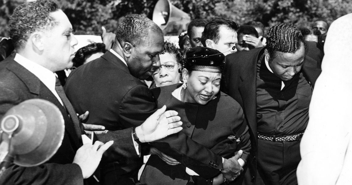 Mamie Bradley, center, reacts as the body of her son, Emmett Till, is lowered into his grave during the funeral in September 1955.