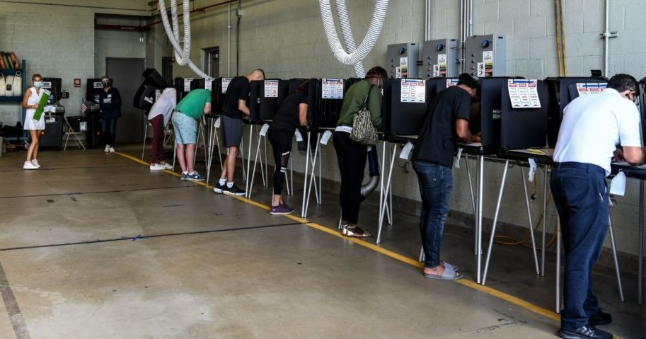 Voters cast their ballots at the Indian Creek Fire Station 4 in Miami on Tuesday.