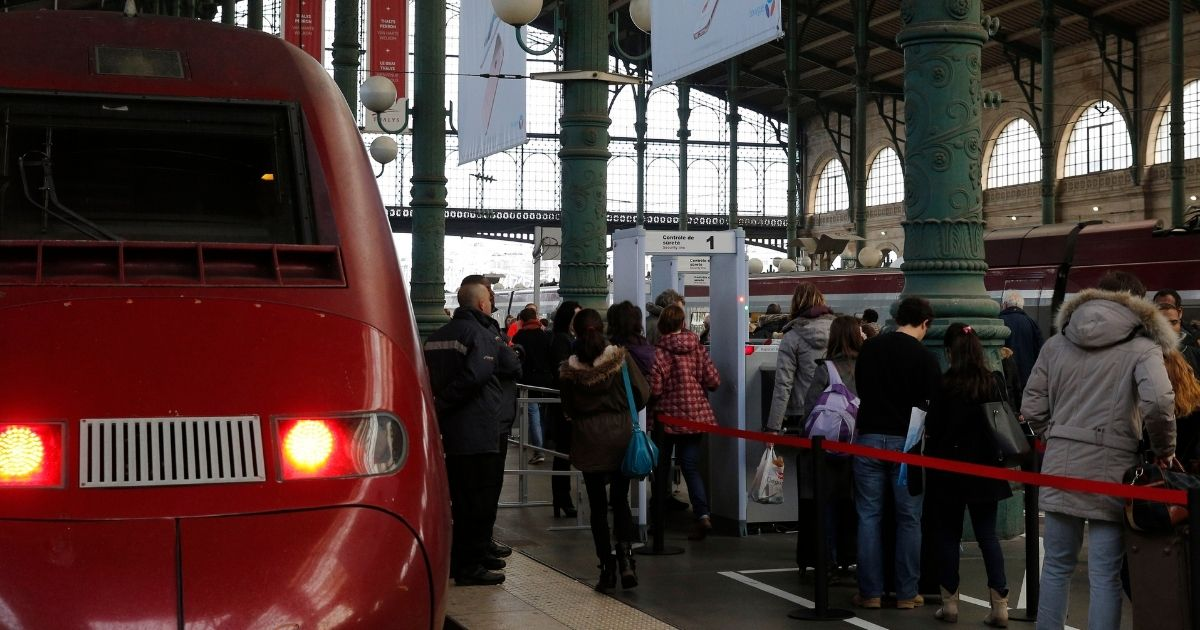 Passengers walk through a metal detector at the Grare du Nord train station in Paris, installed in response to the 2015 terror attack aboard a train.