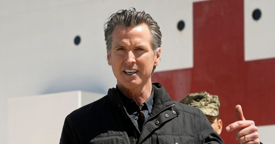 California Gov. Gavin Newsom speaks in front of the hospital ship USNS Mercy that arrived into the Port of Los Angeles on March 27, 2020, to provide relief for Southland hospitals overwhelmed by the coronavirus pandemic.