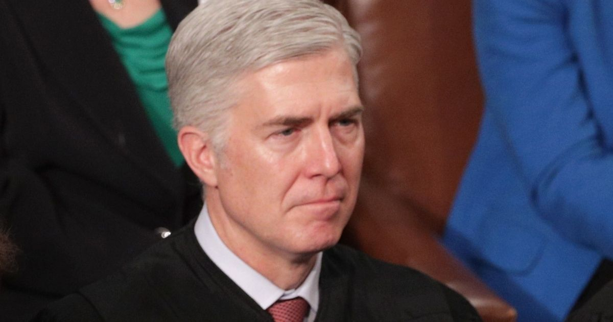 Supreme Court Justice Neil Gorsuch looks on as President Donald Trump delivers the State of the Union address in the chamber of the U.S. House of Representatives in Washington on Feb. 5, 2019.