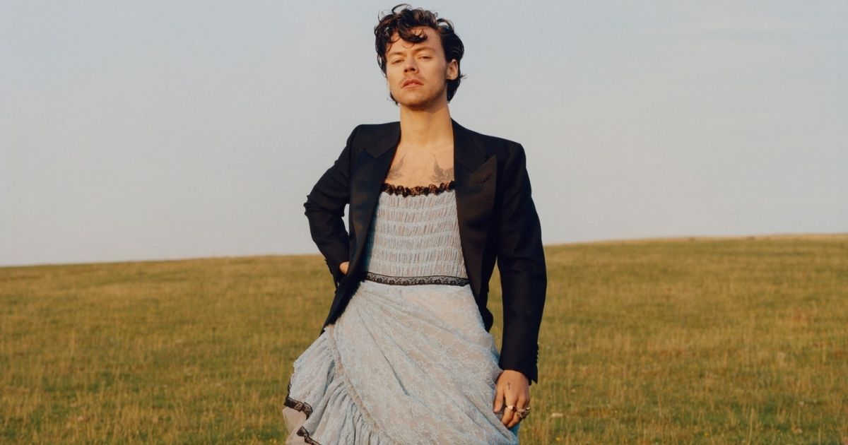 Singer-songwriter Harry Styles poses in a dress for a Vogue photo shoot.