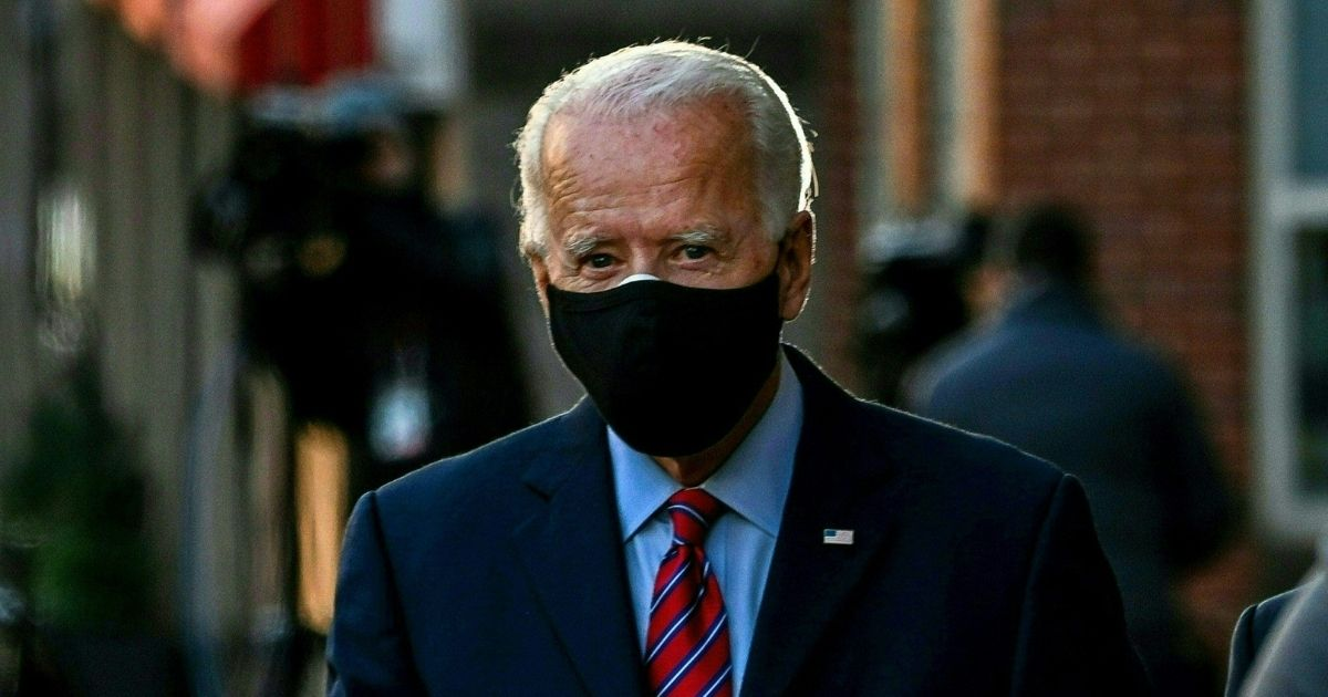Presumptive president-elect Joe Biden leaves the Queen after meeting virtually with the United States Conference of Mayors in Wilmington, Delaware, on Monday.