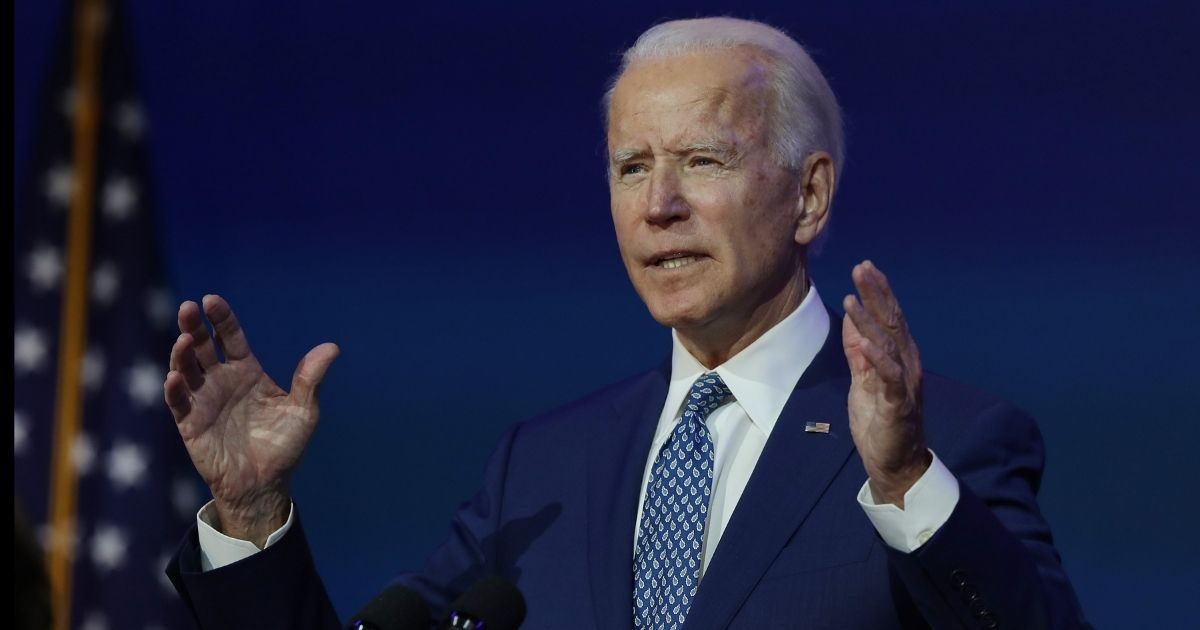 Presumptive president-elect Joe Biden speaks to the media after receiving a briefing from his transition COVID-19 advisory board on Monday at the Queen Theater in Wilmington, Delaware.