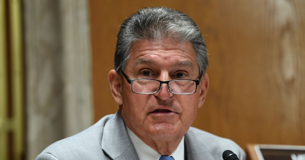 Democratic Sen. Joe Manchin of West Virginia speaks with Ajit Pai, chairman of the Federal Communications Commission, during an oversight hearing on June 16, 2020, in Washington, D.C.