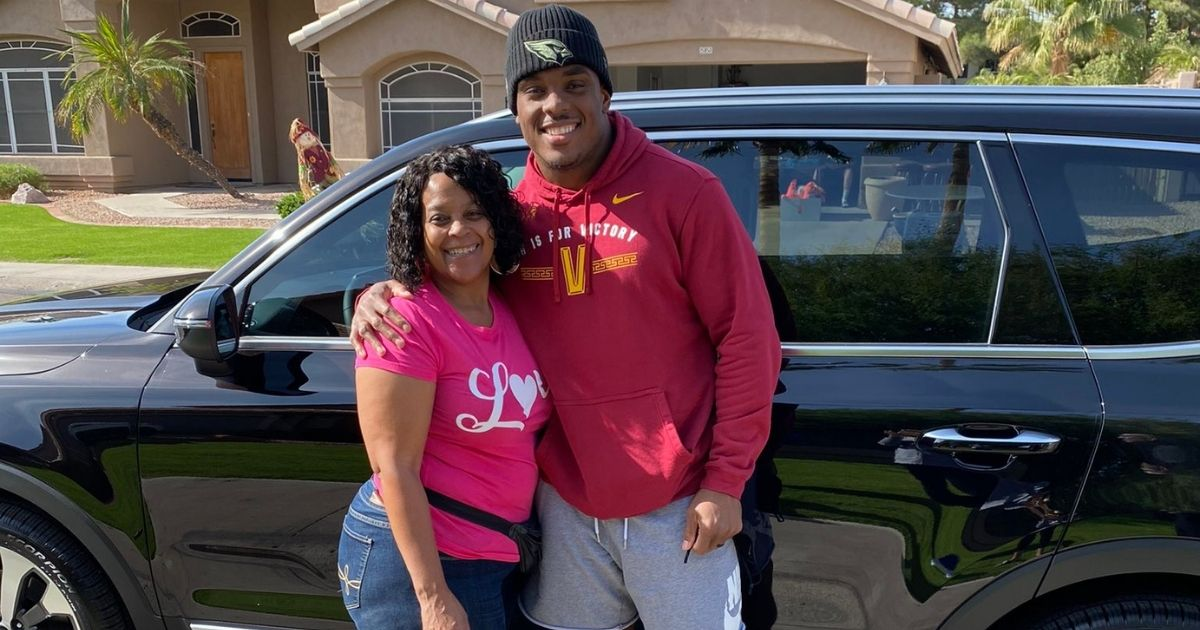 Arizona Cardinals linebacker Devon Kennard with his mother and her new car.