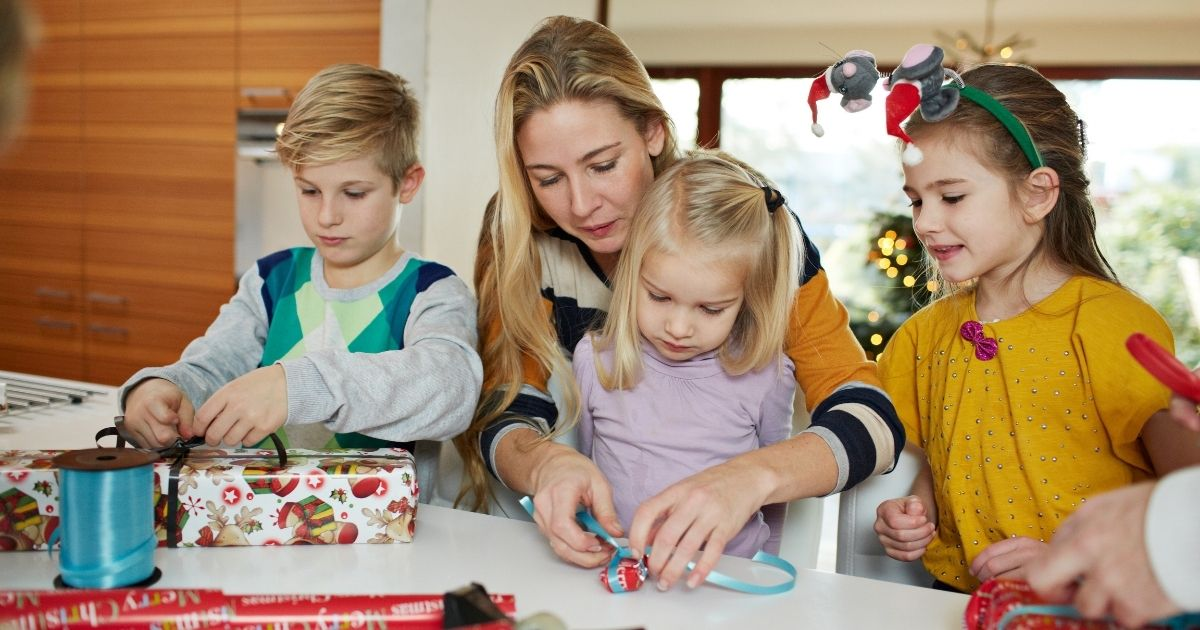 The above photo shows a family wrapping up Christmas presents.