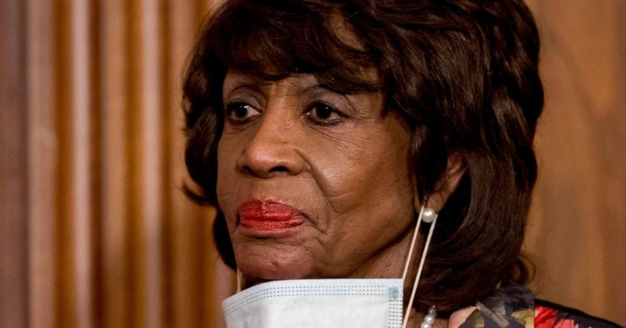 Democratic Rep. Maxine Waters takes her mask off to speak during a signing ceremony on Capitol Hill in Washington on April 23.