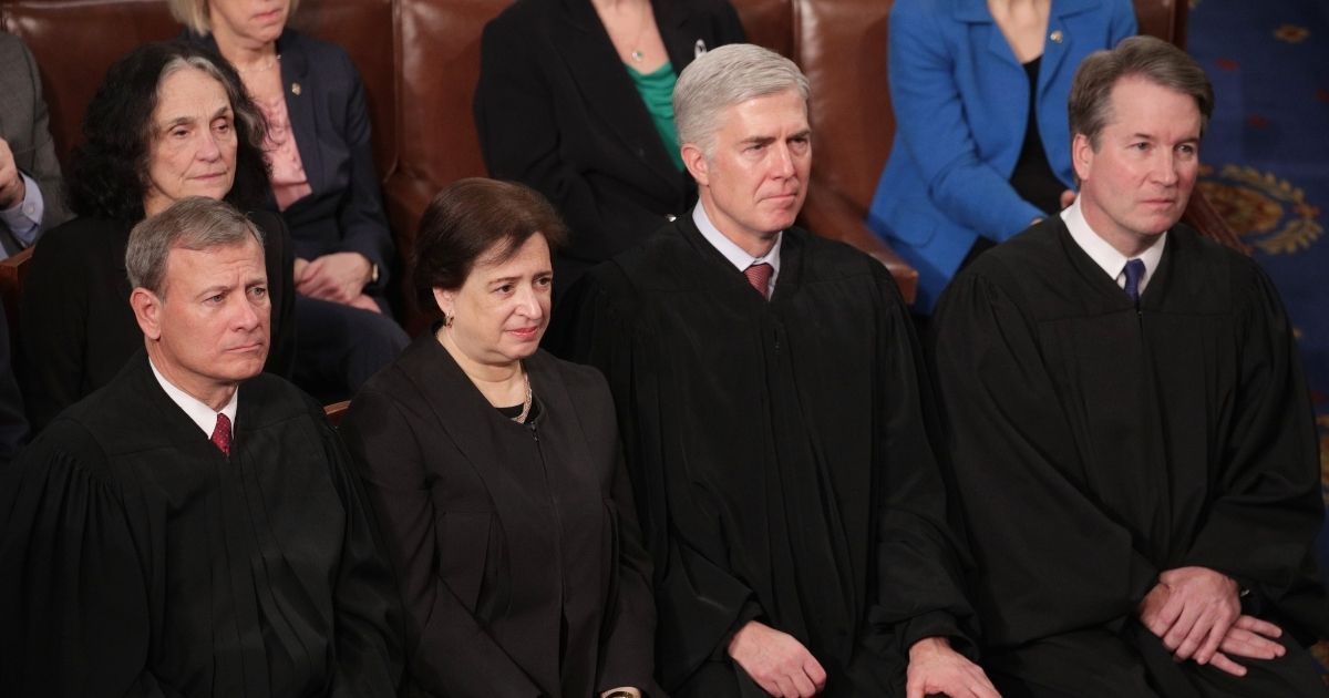 Supreme Court Justices John Roberts, Elena Kagan, Neil Gorsuch, and Brett Kavanaugh look on as President Donald Trump delivers the State of the Union address in the chamber of the U.S. House of Representatives on Feb. 5, 2019 in Washington, D.C.