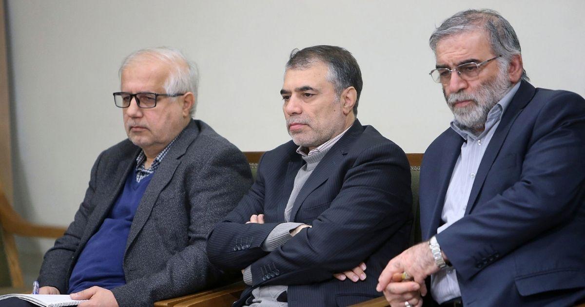 Mohsen Fakhrizadeh sits in a meeting with Supreme Leader Ayatollah Ali Khamenei