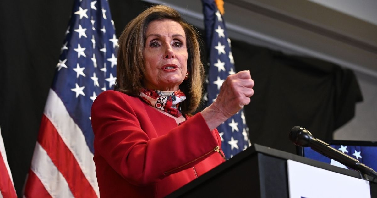 House Speaker Nancy Pelosi talks to reporters about Election Day results in races for the House of Representatives at Democratic National Committee headquarters Tuesday in Washington, D.C.