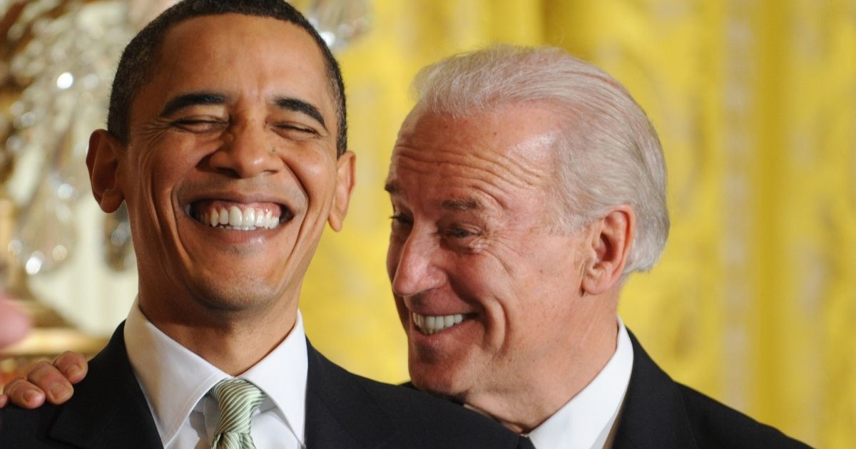 Then-President Barack Obama and his vice president, Joe Biden, laugh during the annual St. Patrick's Day Reception in the East Room of the White House on March 17, 2010.