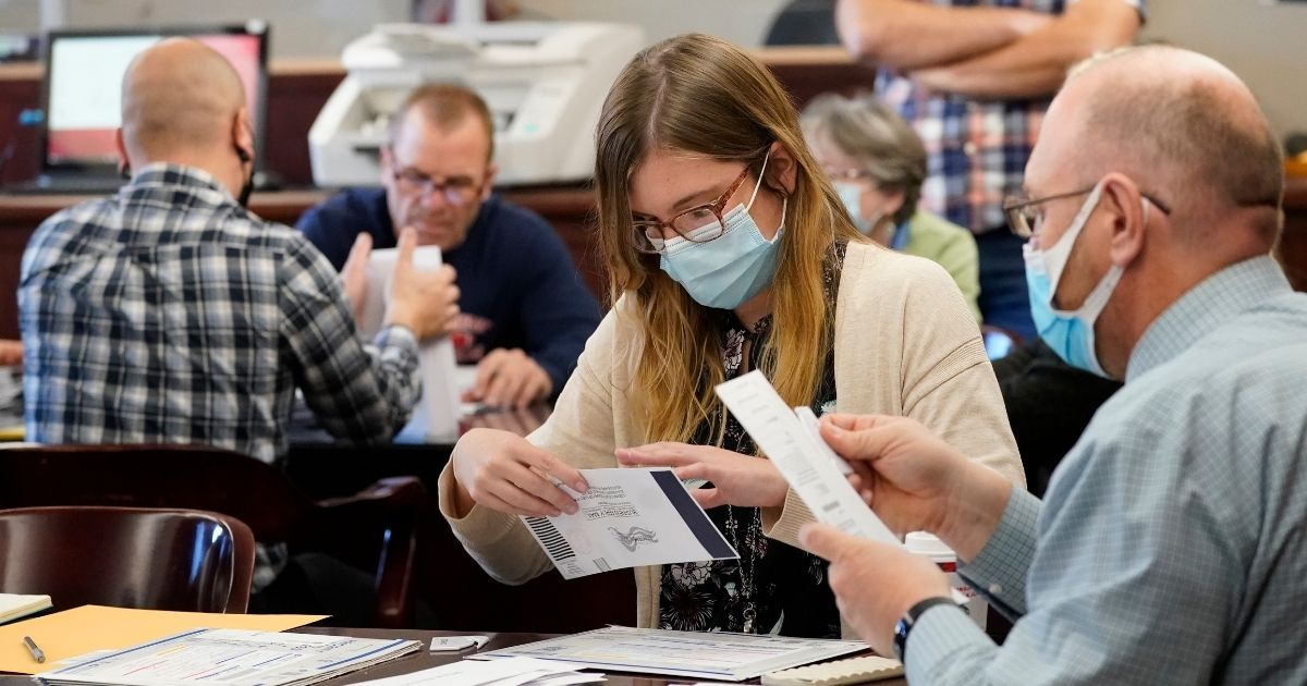 Luzerne County workers canvas ballots as vote counting in the general election continued Friday in Wilkes-Barre, Pennsylvania.