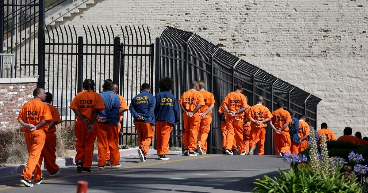 General population inmates walk in a line at San Quentin State Prison in San Quentin, California, on Aug. 16, 2016.