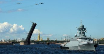 Russian warships sail on the Neva river during the Navy Day parade in Saint Petersburg on July 26.