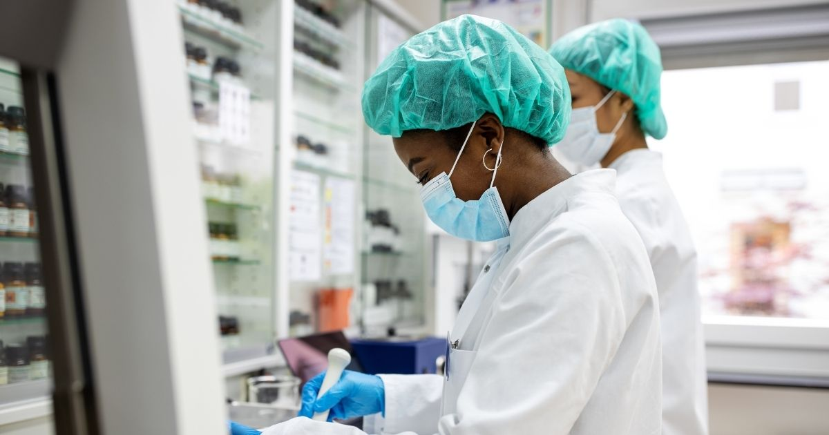 The stock image above shows a chemist developing new medicine in a laboratory.