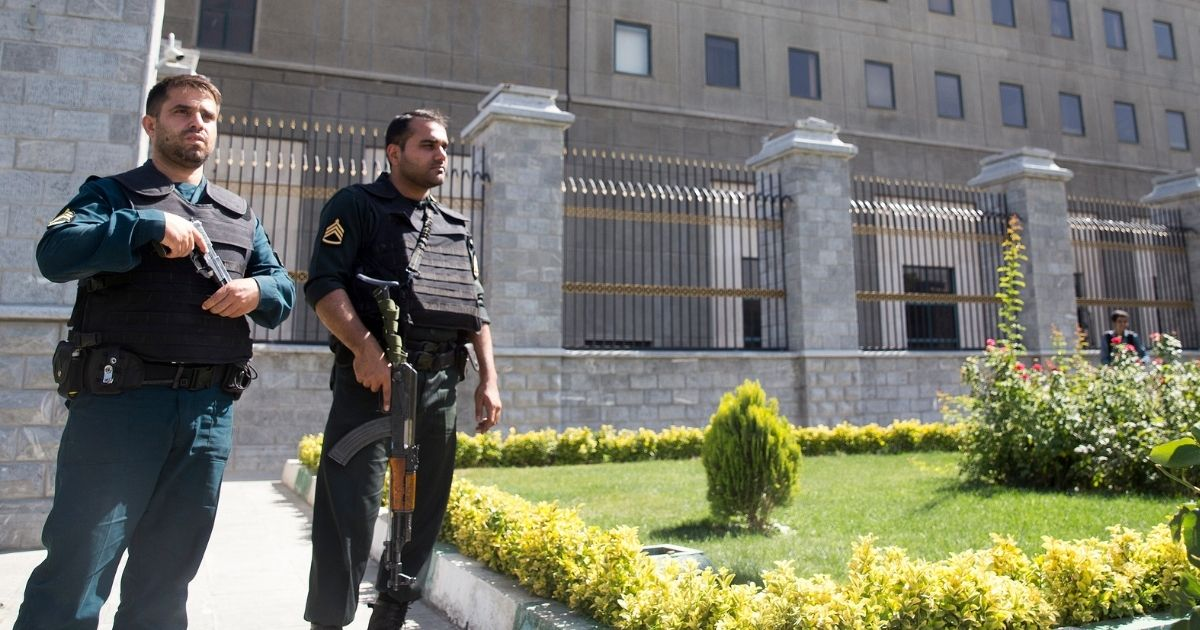 Police officers stand outside Iran's parliament building following an attack by several gunmen on June 7, 2017, in Tehran.