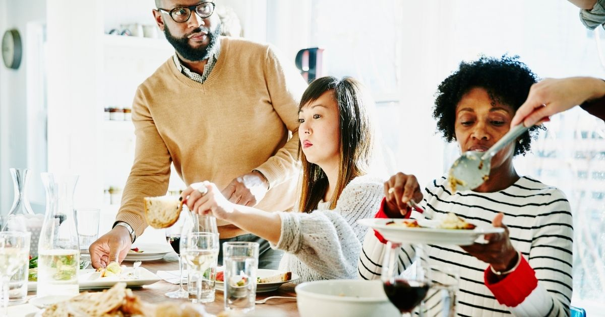 The above stock photo shows people gathered together during Thanksgiving.