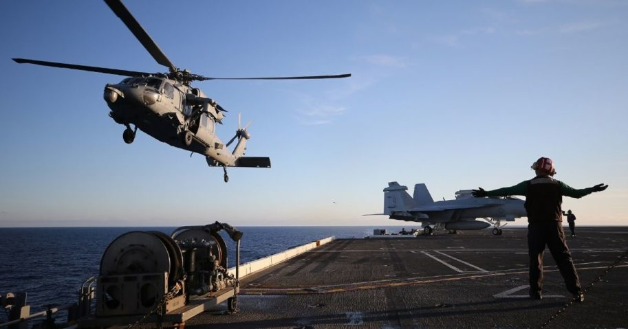 A U.S. Navy helicopter descends to land on the flight deck of the USS Nimitz (CVN 68) aircraft carrier while at sea on Jan. 18 off the coast of Baja California, Mexico.