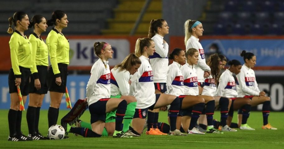 Members of the U.S. Women's National Team kneel during the national anthem before a friendly match against the Netherlands at Rat Verlegh Stadium in Breda on Friday.