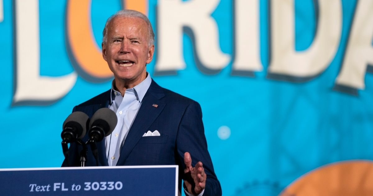 Democratic presidential candidate Joe Biden speaks during a drive-in campaign rally at the Florida State Fairgrounds on Thursday in Tampa.