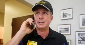 Walt Ehmer, president and CEO of the Waffle House restaurant chain, speaks on the phone after landing in Wilmington, North Carolina, with an emergency response team shortly after Hurricane Florence struck the Tar Heel State in September 2018.