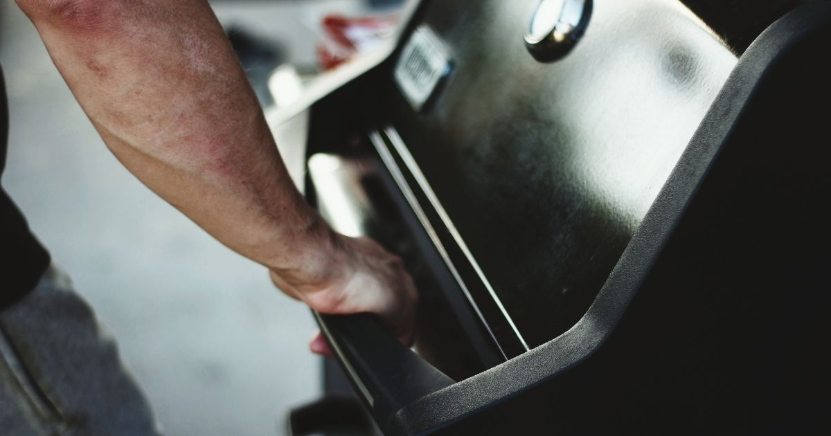 In this stock photo, a man grabs the handle of a gas grill. In Clearwater, Florida, residents such as former fire inspector Salvatore Betti, 72, are uniting in an effort to keep their grills at a 55-plus community.