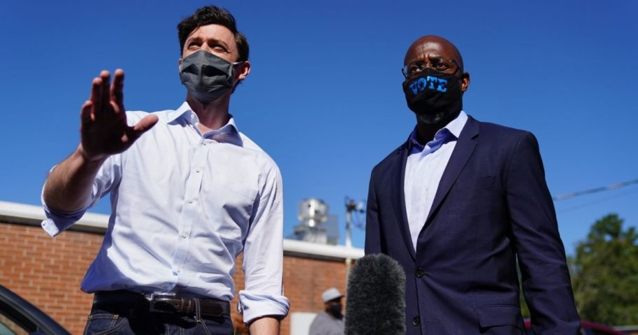 Democratic U.S. Senate candidates Jon Ossoff and Raphael Warnock campaign at an event in Lithonia, Georgia, on Oct. 3, 2020. The two hope to unseat incumbent Senators David Perdue and Kelly Loeffler.