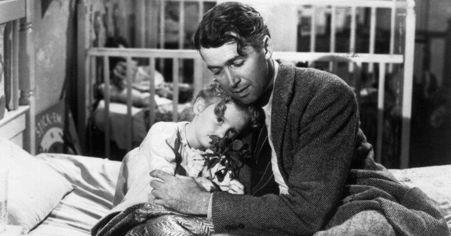 Actor Jimmy Stewart, portraying George Bailey, hugs actor Karolyn Grimes (portraying Zuzu, his daughter) in a still photo from the 1946 classic Christmas film 'It's a Wonderful Life.'