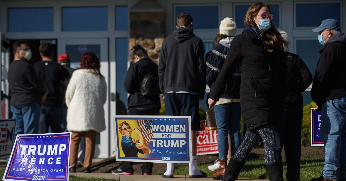 Voters wait to cast their ballots Tuesday at the Cranberry-Highlands Golf Club in Cranberry Township, Pennsylvania.