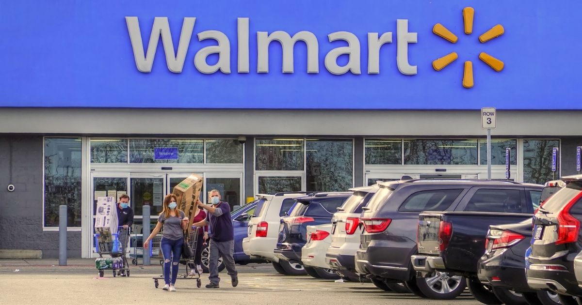 Shoppers enter and leave a Walmart store in Peabody, Massachusetts, on May 2.