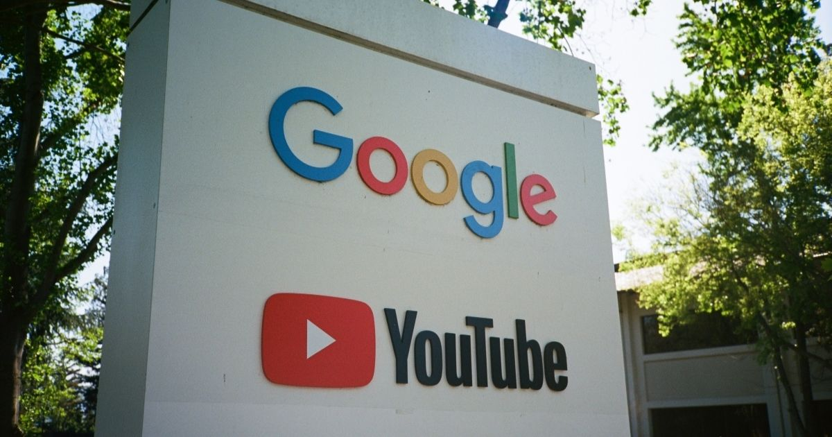 Sign with logos for Google and the Google owned video streaming service YouTube at the Googleplex, the Silicon Valley headquarters of search engine and technology company Google Inc in Mountain View, California, April 14, 2018.