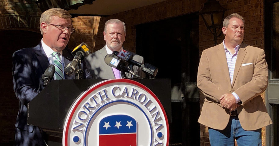 Republican North Carolina House Speaker Tim Moore speaks to reporters with Senate leader Phil Berger, left, and House Majority Leader John Bell, right, at a news conference on Nov. 4, 2020, at state GOP headquarters in Raleigh, North Carolina, to discuss Election Day results.