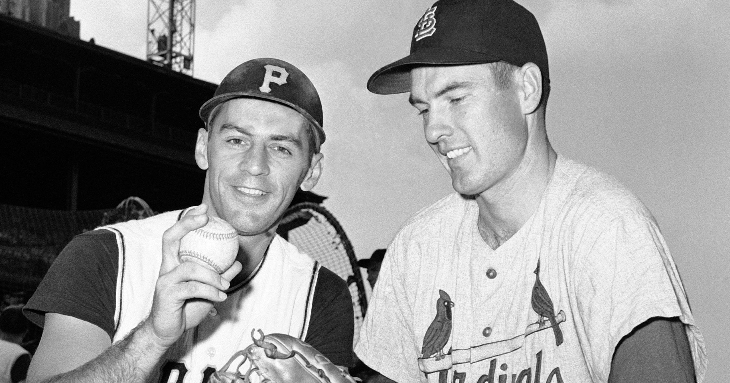 Shortstop Dick Groat, left, of the Pittsburgh Pirates, and pitcher Lindy McDaniel of the St. Louis Cardinals talk at Forbes Field in Pittsburgh on Aug. 11, 1960.