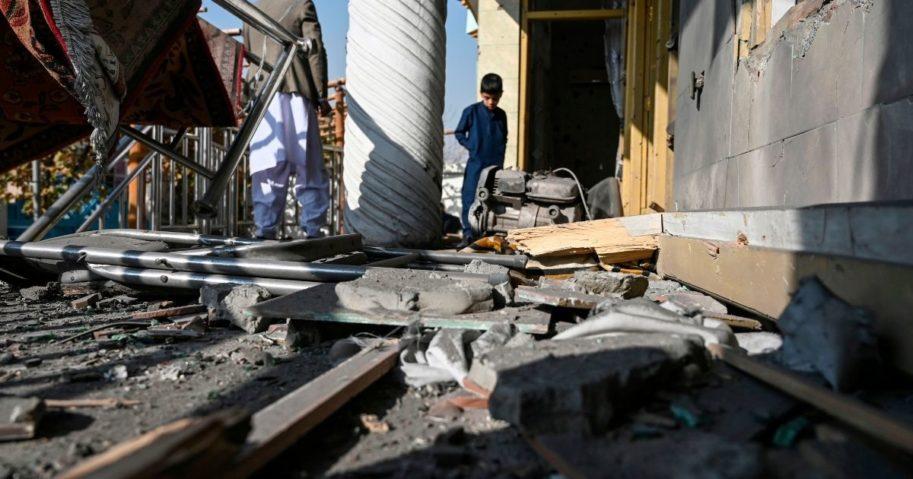People inspect a damaged house after several rockets landed in Kabul, Afghanistan, on Nov. 21, 2020.