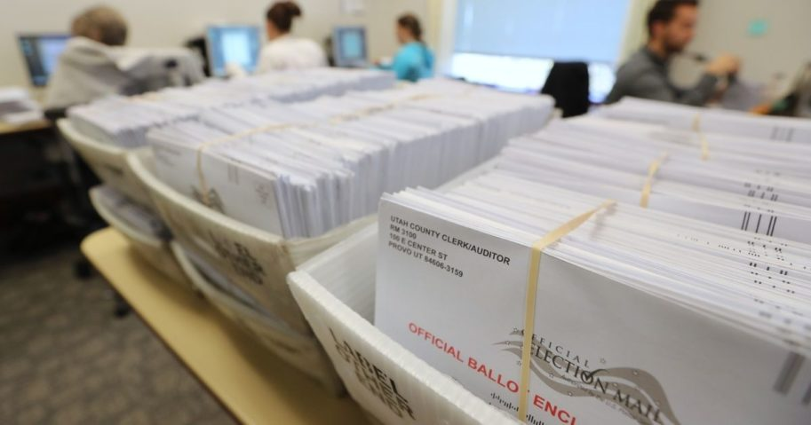 Thousands of ballots sit in boxes on Nov. 6, 2018, in Provo, Utah.