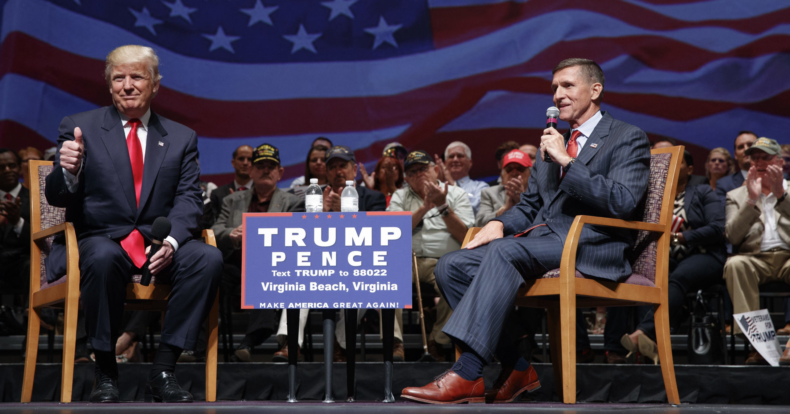 Then-presidential candidate Donald Trump gives a thumbs-up as he speaks with retired Lt. Gen. Michael Flynn on Sept. 6, 2016, in Virginia Beach, Virginia.