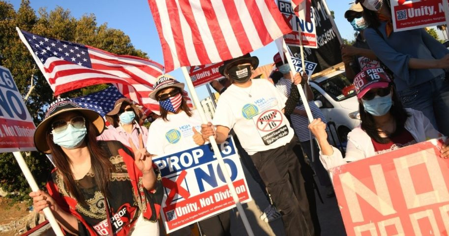 Protesters wave American flags as they demonstrate against Prop. 16 on Oct. 30, 2020, in Los Angeles, California.