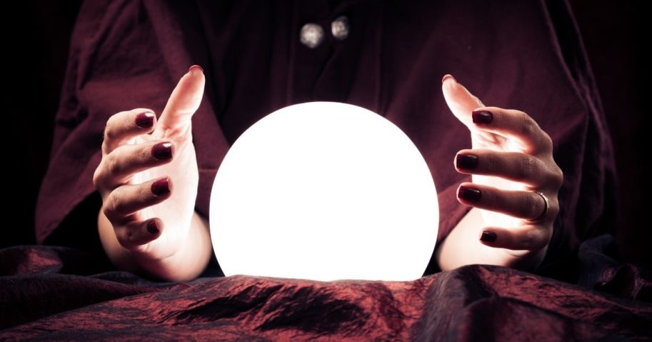 Hands around a crystal ball.