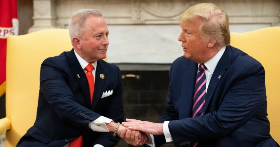 Rep. Jeff Van Drew of New Jersey shakes hands with President Donald Trump in the Oval Office of the White House on Dec. 19, 2019, in Washington, D.C.