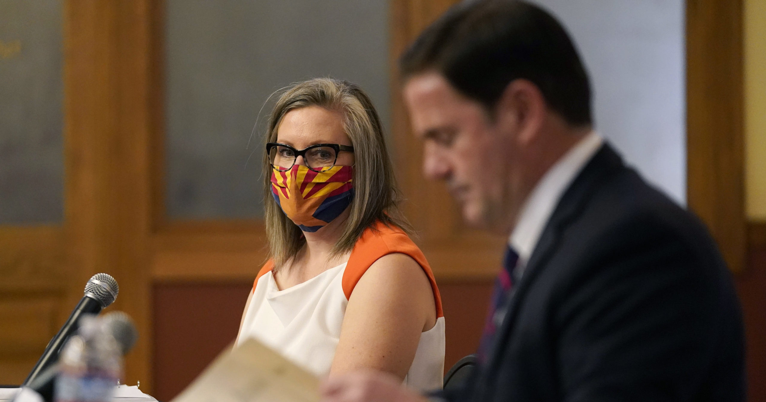 Arizona Secretary of State Katie Hobbs watches as Arizona Gov. Doug Ducey signs election documents to certify the election results at the Arizona Capitol on Nov. 30, 2020, in Phoenix.