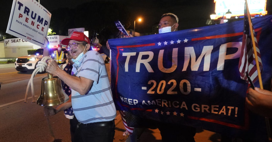 In this Nov. 3, 2020, photo, supporters of President Donald Trump chant and wave flags outside a Cuban restaurant during a celebration on election night in the Little Havana neighborhood of Miami.