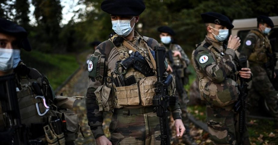 French soldiers of the Sentinelle force get ready before setting off on a patrol at an undisclosed location in northern suburban Paris on Nov. 6, 2020. The Sentinelle force protects sensitive points of France from terrorism.