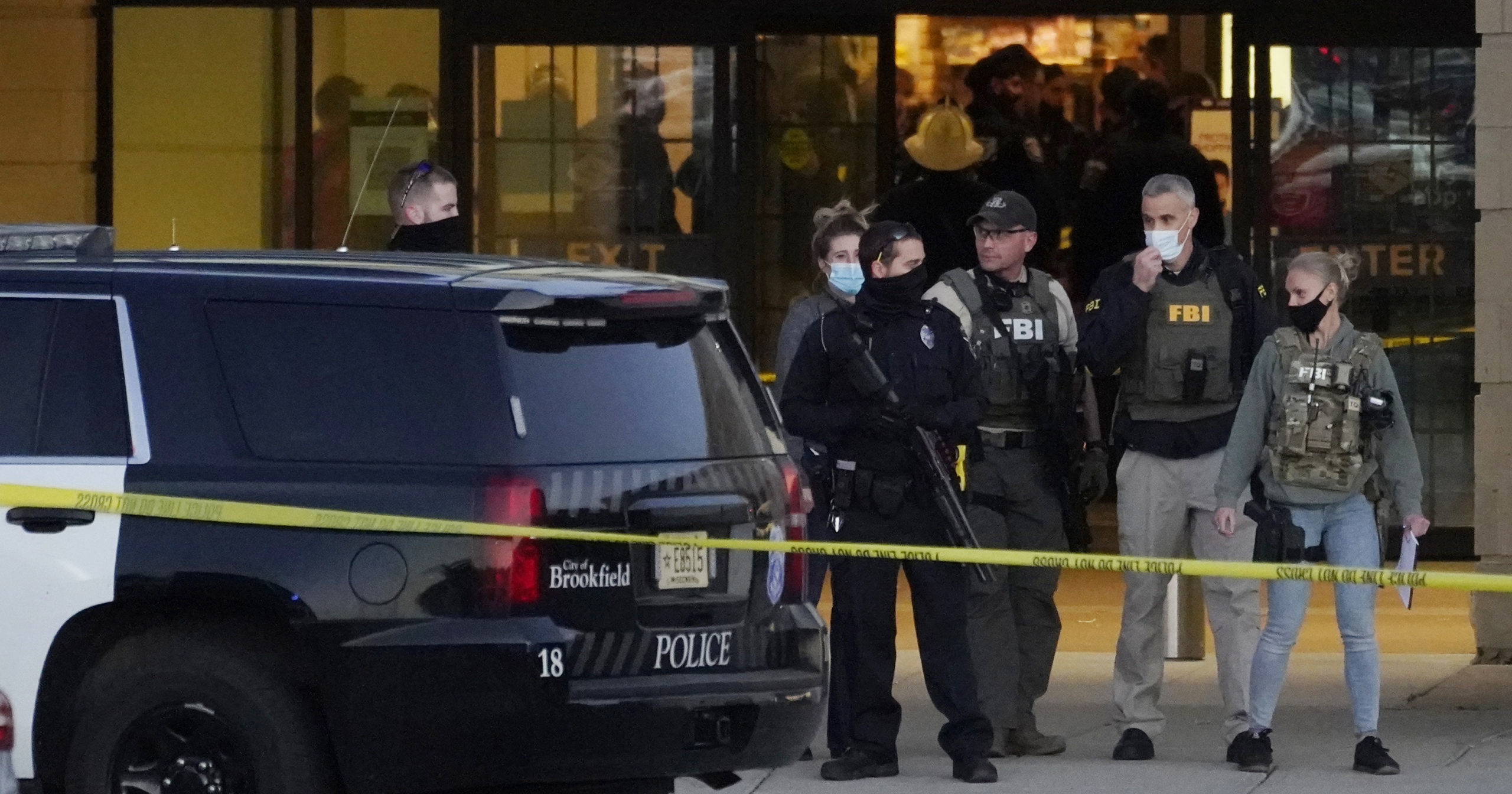 FBI officials and police stand outside the Mayfair Mall after a shooting on Nov. 20, 2020, in Wauwatosa, Wisconsin.