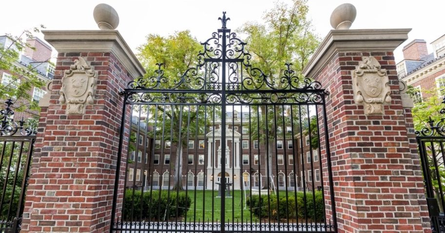 A gate on the campus of Harvard University is seen in this stock image.