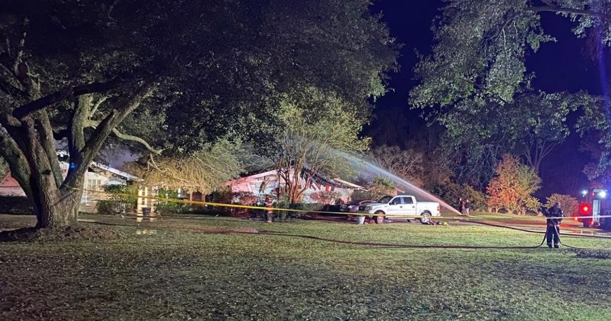 Firefighters work to put out the fire where two women were trapped and one died in Richland Parish, Louisiana, on Nov. 23.