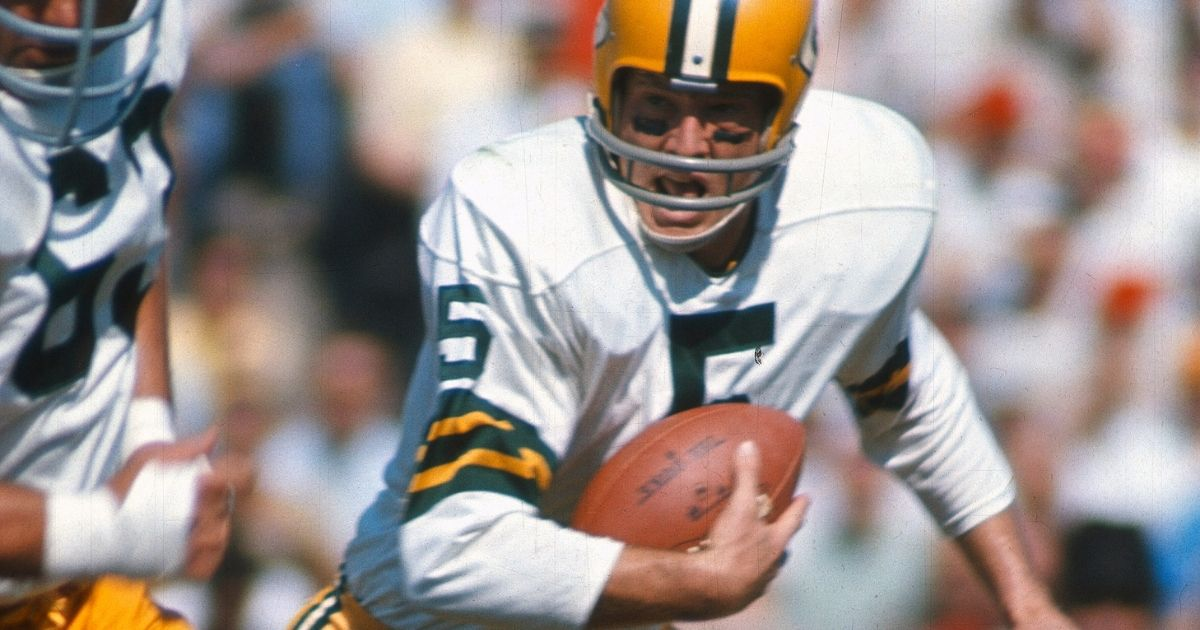 Paul Hornung of the Green Bay Packers carries the ball against the Baltimore Colts during an NFL football game on Oct. 28, 1962, at Memorial Stadium in Baltimore, Maryland.