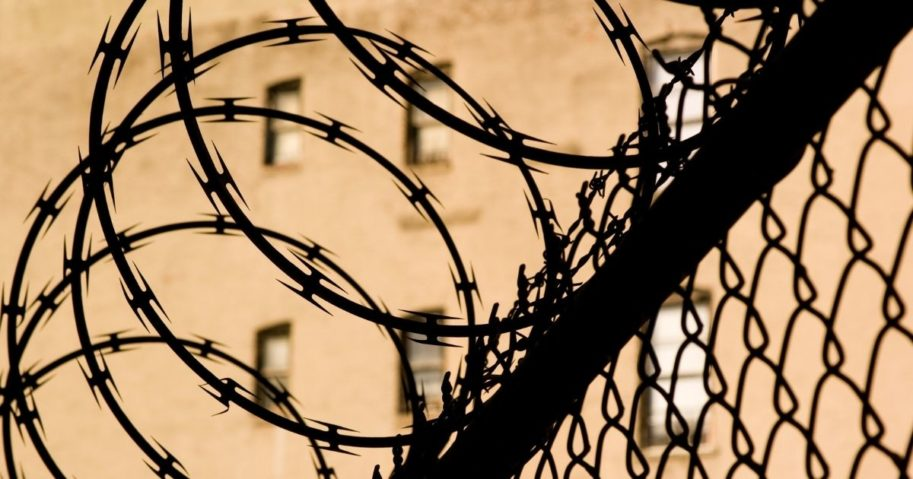 A barbed wire fence is seen in this stock image.